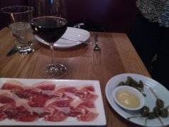 Jamon Iberico de bellota. Appetizer of caper berries and baby gherkins with spicy mustard.