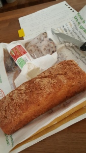 Gluten-free baguette and log of chevre cheese