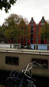 Amsterdam rowhouses, houseboat, and bike