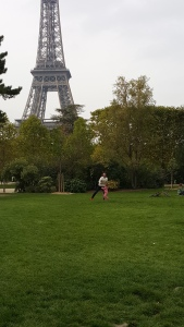 Father - daughter playing in front of Eiffel Tower